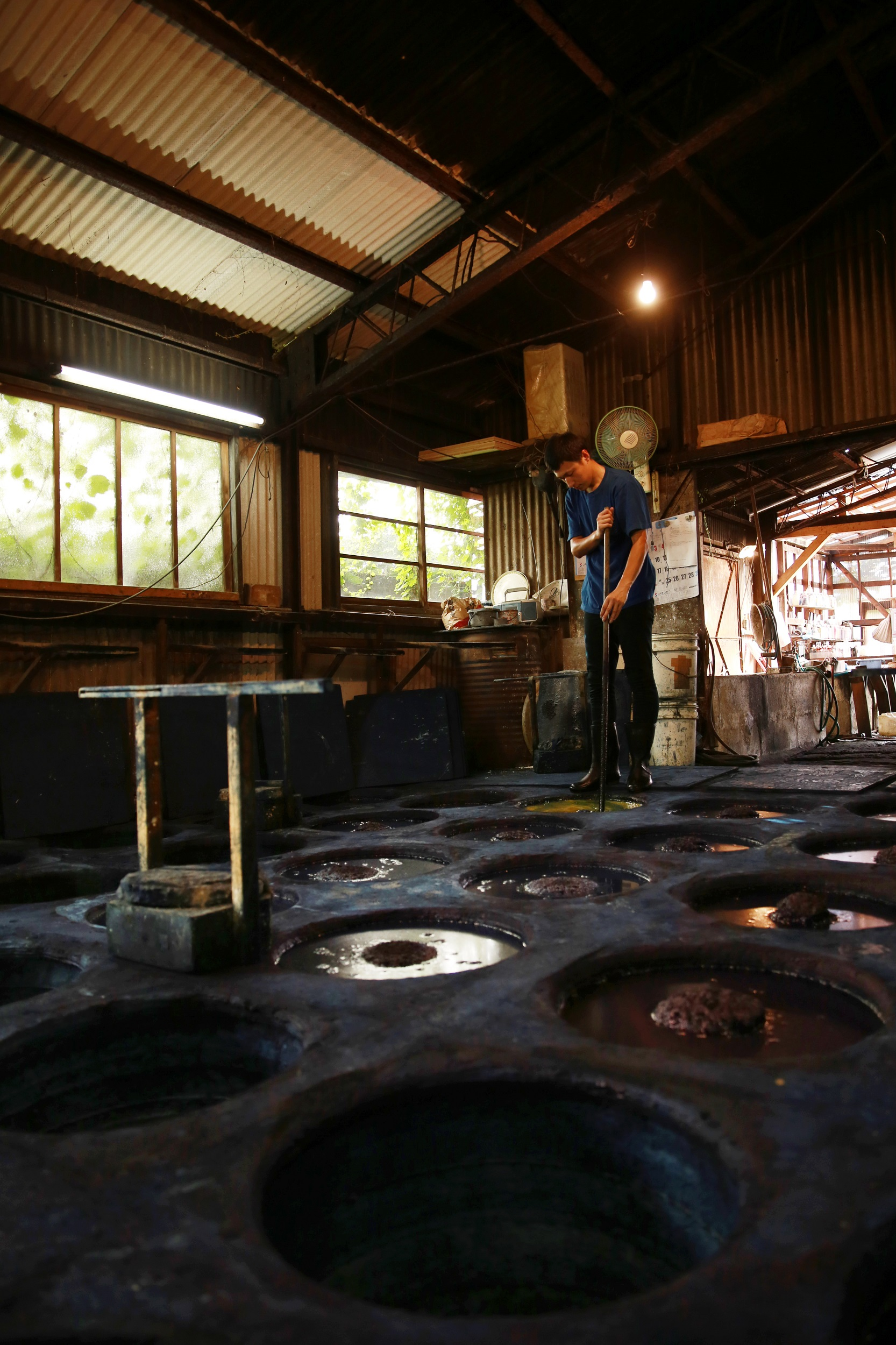 All done by hand with attention and care. The indigo dyeing process using indigo vats at their own dye workshop.